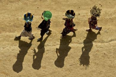 Young girls carrying buckets, Mali